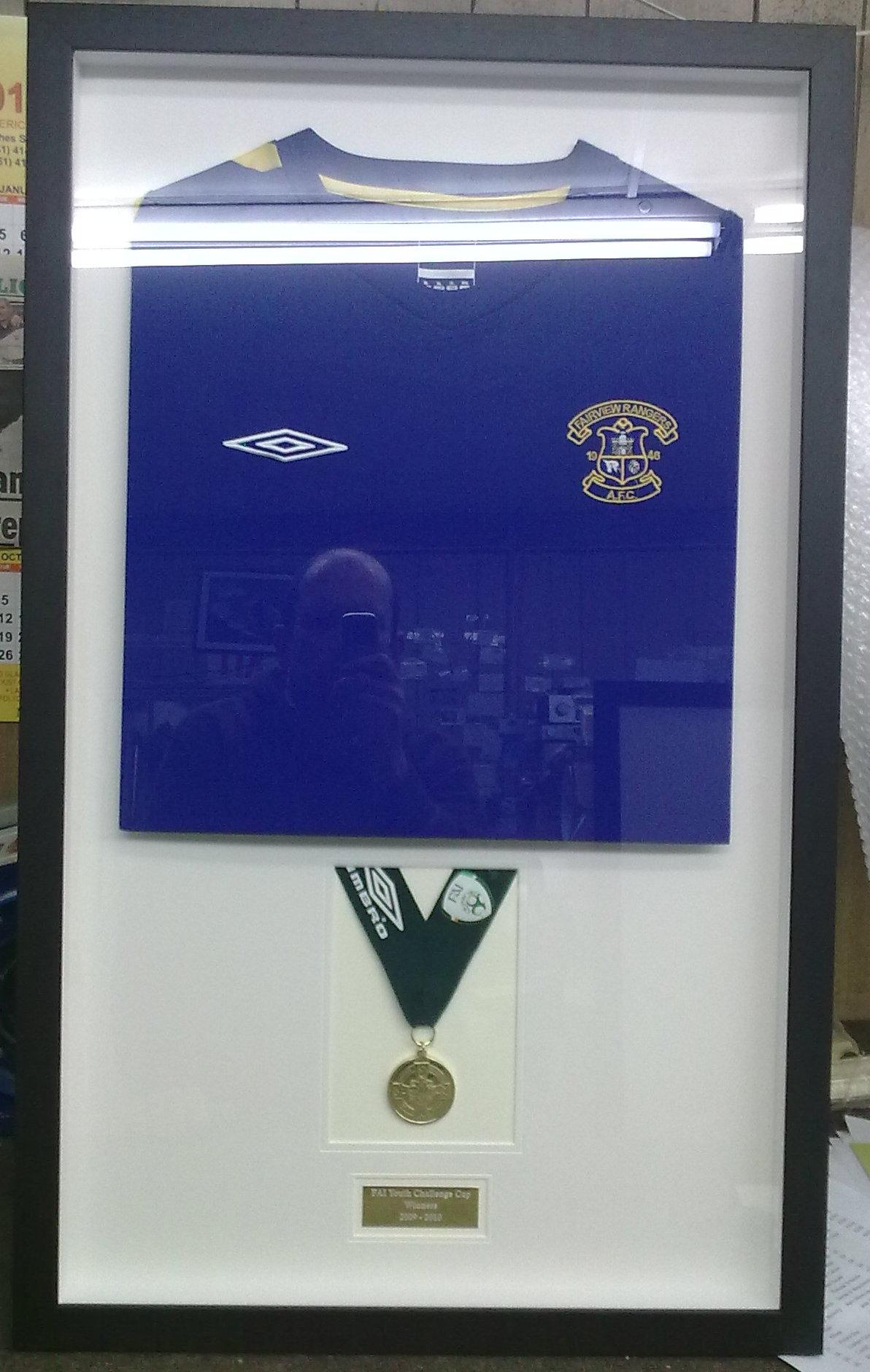 Framed  jersey and medal