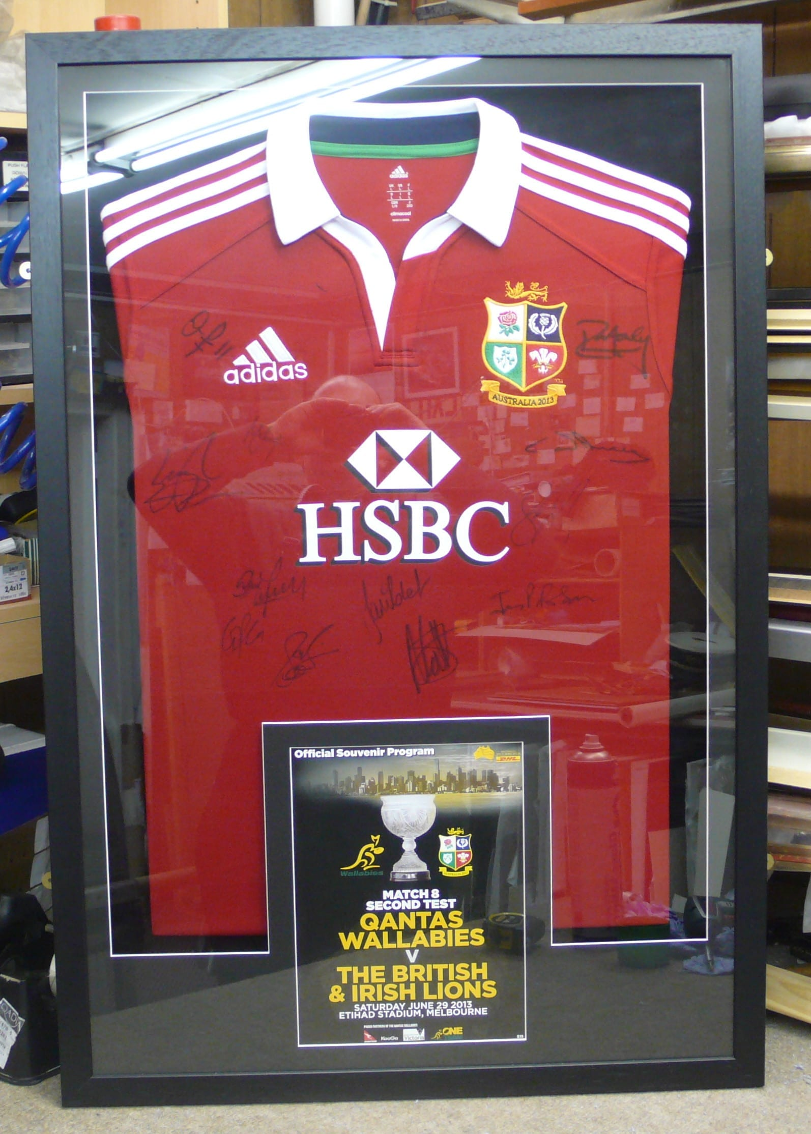 Framed Lion's Jersey with program