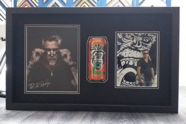 frame with two photos and a can